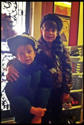 the Outdoor Boys in their winter uniforms of skunk and coon hats